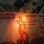 Средневзвешенный курс доллара снизился на 1,26 рубля