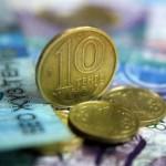 Казахстанцев будут переводить с долларов на тенге