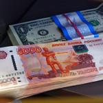 Курс доллара упал ниже 55 рублей
